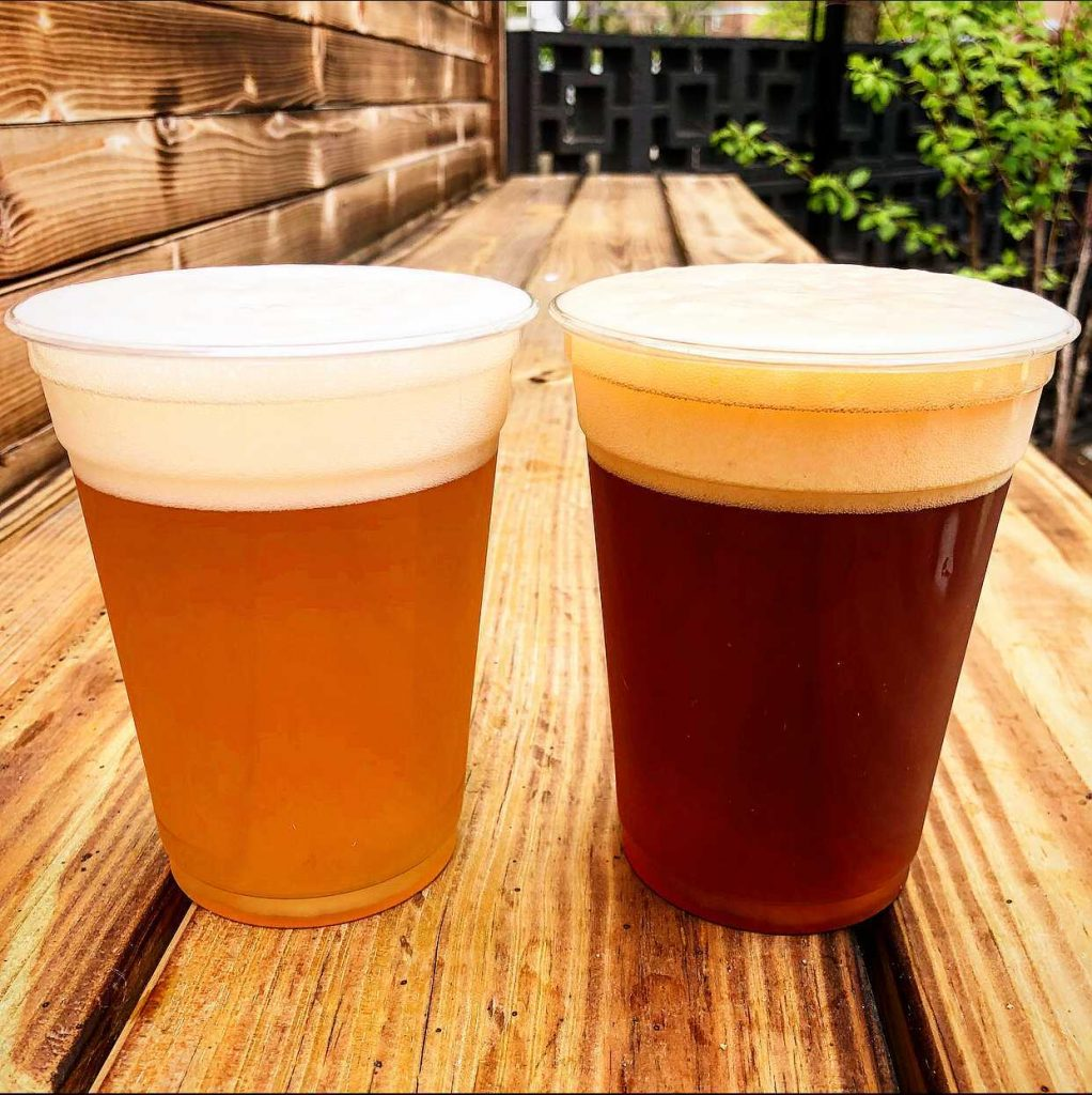 two 12-oz cups of draft beer