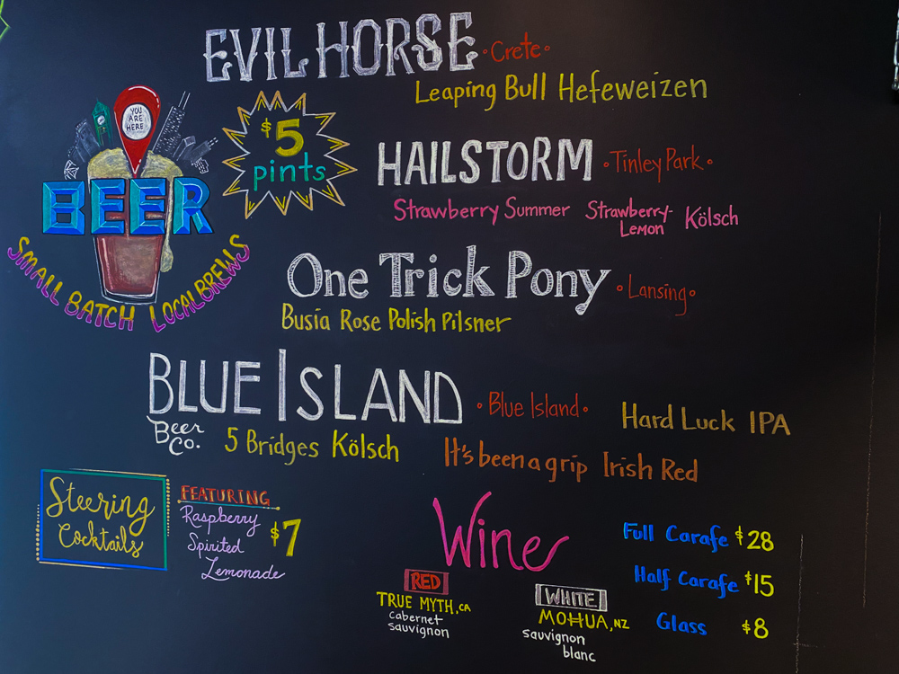 Nicky's chalkboard menu shows beer, wine, and cocktail offerings
